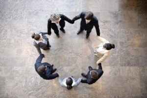Above shot of people holding hands in a circle